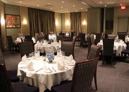 Arlington & Chestnut rooms combined with round tables to seat 80