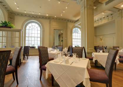 The Philadelphia main dining room features high arched windows and seats up to 180