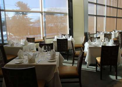 The semi-private Newbury Room can be set up with small square table for a seated capacity of 16