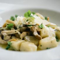 Hand-rolled potato gnocchi, organic mushrooms, basil, white truffle oil