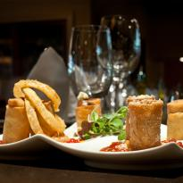 Trio of spring rolls with spicy ketchup and crispy onions