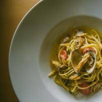 Linguini with clams, oven roasted cherry tomatoes, clam broth, and parsley