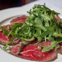 Beef Carpaccio, Arugula, Capers, Lemon, Olive Oil