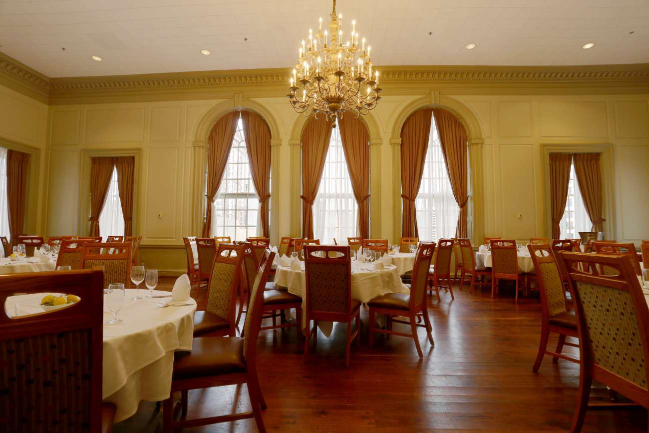 The Director's Room with round tables holds up to 104 guests