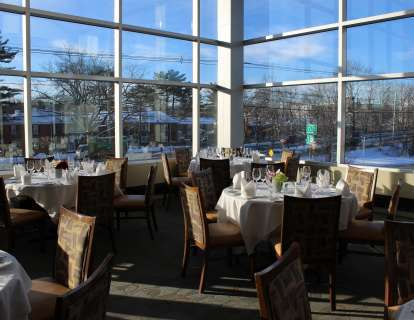 When set with round tables for six, the Boylston Room has a seated capacity of 64