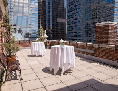 The patio can be set with cocktail tables and boasts a view of the city skyline