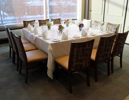 The semi-private Newbury Room can be set up with one large square table, seating 12