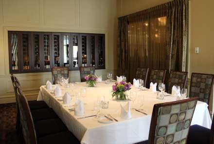 The Wine Room features a wall of wine storage, a tall window, and can be set conference style with a table for 12