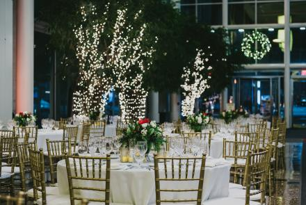 The Galleria space in the 45 St. James lobby decorated with lights and greenery for a holiday celebration