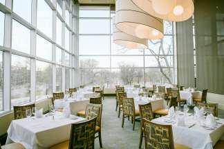 Wall-to-wall windows and dramatic lighting fixtures are the hallmarks of this beautiful event space